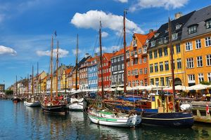 Boats and colourful houses at Nyhavn Quay in Copenhagen, Denmark