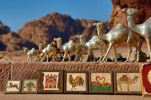 Camel souvenirs on sale at the Urn Tomb of the Royal Tombs in the rock city of Petra