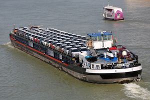 Cargo ship transporting motor cars on the River Danube, Budapest, Hungary