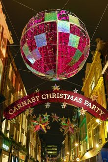 Carnaby Street Christmas Decorations shaped like balls and stars in London, England
