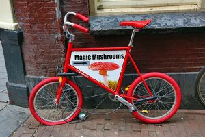 Child's bicycle advertising, Magic Mushroom drugs in Amsterdam, Holland