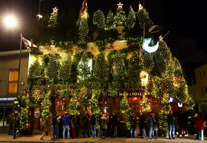 Churchill Arms Pub covered in Christmas Trees in Kensington, London