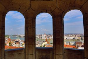 City skyline seen through a window of the Fisherman's Bastion in Budapest, Hungary