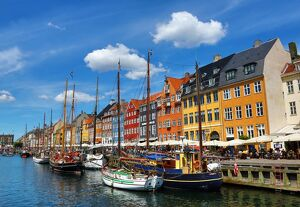Coloured houses and boats at Nyhavn Quay in Copenhagen, Denmark