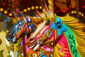 Colourful painted horses on a fairground carousel