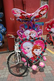 Decorated kitsch cycle trishaw rickshaw with soft toys in Malacca, Malaysia