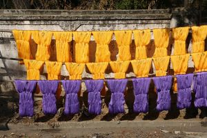 Dyeing and drying coloured yarn for the weaving industry in Amarapura, Mandalay, Myanmar