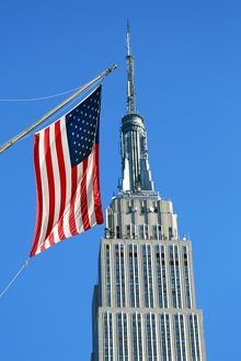 The Empire State Building and Stars and Stripes American flag, New York. America