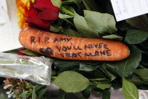 Flowers left by mourners after the death of Amy Winehouse