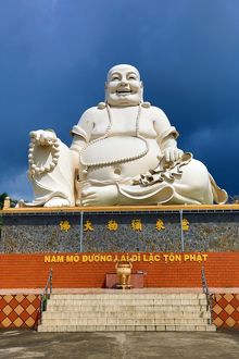 Giant Buddha statue at Vinh Trang Temple, near My Tho, Mekong Delta, Vietnam