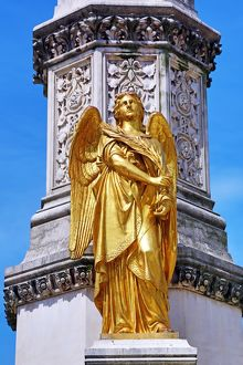 Gold angel statue on the column beside Zagreb Cathedral in Zagreb, Croatia