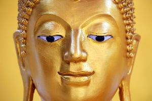 Gold Buddha statue head and face at Wat Panping Temple in Chiang Mai, Thailand