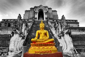 Gold Buddha statue at the Wat Chedi Luang temple, Chiang Mai, Thailand