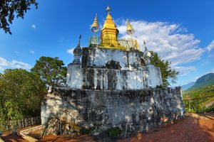 Golden Wat That Chomsi temple Stupa on Mount Phousi in Luang Prabang, Laos