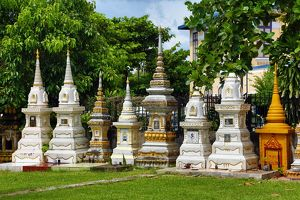Graves in a cemetery at Wat Si Saket Buddhist Temple, Vientiane, Laos