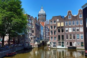 Houses on the Oudezijds Kolk Canal and the Basilica of Saint Nicholas in Amsterdam