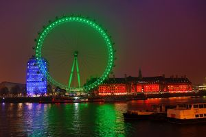 The London Eye goes green to celebrate St. Patrick's Day in London, England