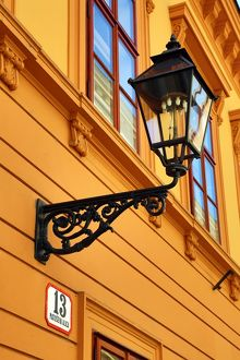 Metal street lamp on a building in Matoseva Ulica in Zagreb, Croatia