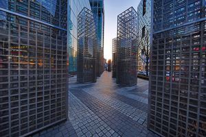 Metal structures beside the office blocks at dusk in the Gangnam district, Seoul, Korea