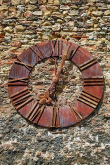 Old rusty clock on the wall beside Zagreb Cathedral in Zagreb, Croatia