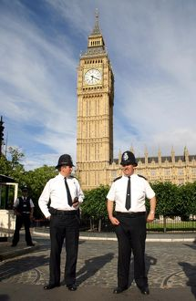 Policemen outside the Houses of Parliament and Big Ben, London