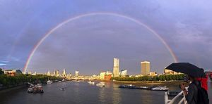 Rainbow over the River Thames and City of London, England