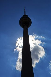 Silhouette of the Berlin TV Tower, Fernsehturm, television tower and a cloud in Berlin