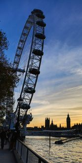 Silhouette of Millennium Wheel and Houses of Parliament at Sunset in London