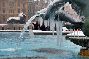 Snow and ice on frozen fountains in Trafalgar Square, London
