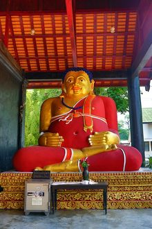 Statue of the fat Monk Tan Pra Maha Kajjana at Wat Chedi Luang Temple in Chiang Mai