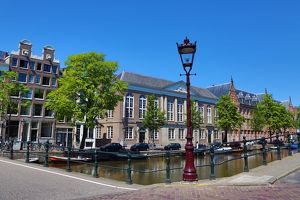 Street scene with lamppost and canal in Amsterdam, Holland