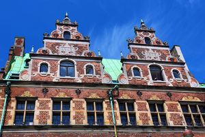Traditional architecture of the Royal Copenhagen shop building roof in Stroget in