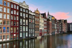 Traditional houses on the Damrak canal in Amsterdam, Holland