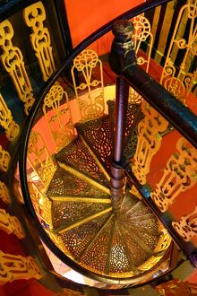 Traditional ironwork spiral staircase in a restaurant in Malacca, Malaysia