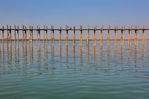 The U Bein Bridge across the Taungthaman Lake in Amarapura, Mandalay, Myanmar (Burma)