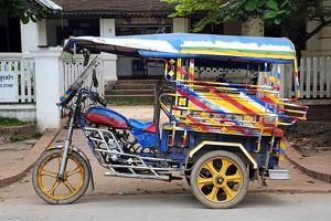 Three wheeled Tuk Tuk taxi in Luang Prabang, Laos