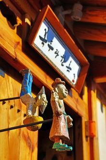 Wooden figures on a traditional building in the old town of Bukchon Hanok village in Seoul