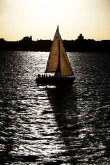 Yacht sailing on the sea at sunset