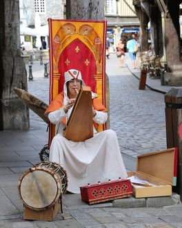 Medievial busker, Dinan, Brittany, France