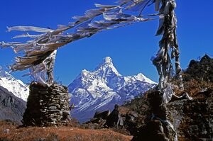 Amma Dablam (west face) framed by prayer flags