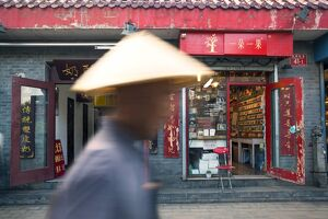 oriental flavours/beijing china old man conical hat passing shop