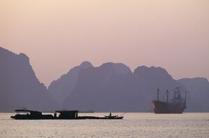 Boats in Ha Long Bay at Sunset