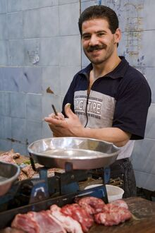 A butcher in the souq, Aleppo, Syria
