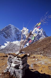 Cairn and prayer flags in the Dzonglha area