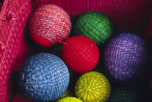 Christmas decorations woven from straw fibre are colourful
