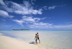 Couple on a beach, Aitutaki, Cook Islands