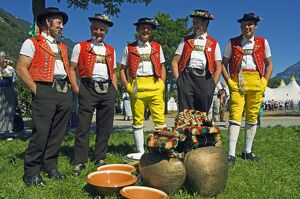 Cowbell ringers in Traditional Alpine Costume at the