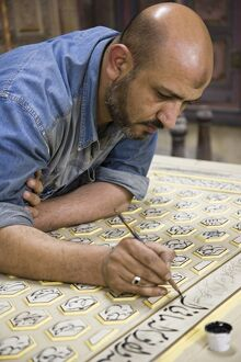 A craftsman restores a traditional house in Damascus