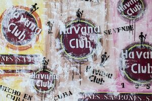 Cuba, Trinidad, Havana Club painted on wall of bar in historical center