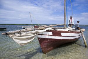 A dhow captain waits for high tide in the harbour of Ibo Island